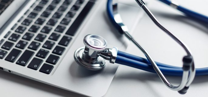 Stethoscope on the laptop keyboard. Medicine concept.