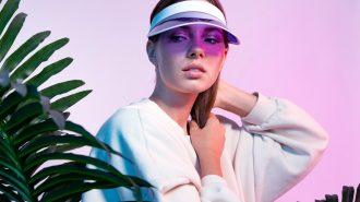 Fashion,Woman,Posing,In,Purple,Headdress,Near,Tropical,Tree.,Beautiful