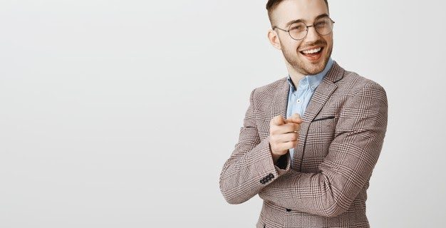 pleased-handsome-businessman-pointing-person-making-good-point-nice-job-praising-employee-saying-well-done_176420-21751