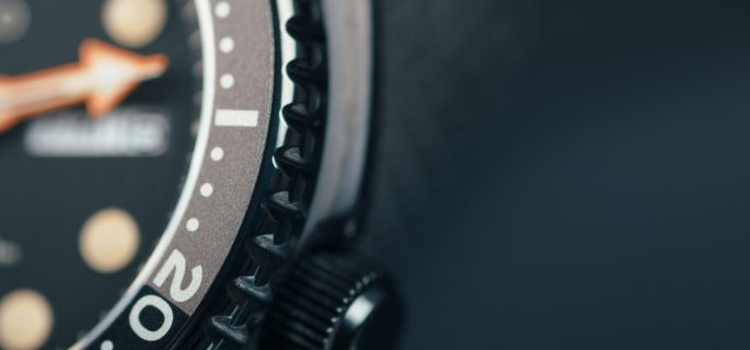 Diver,Watch,Close,Up,Dial.,Bezel,And,Crown.,Dark,Background.